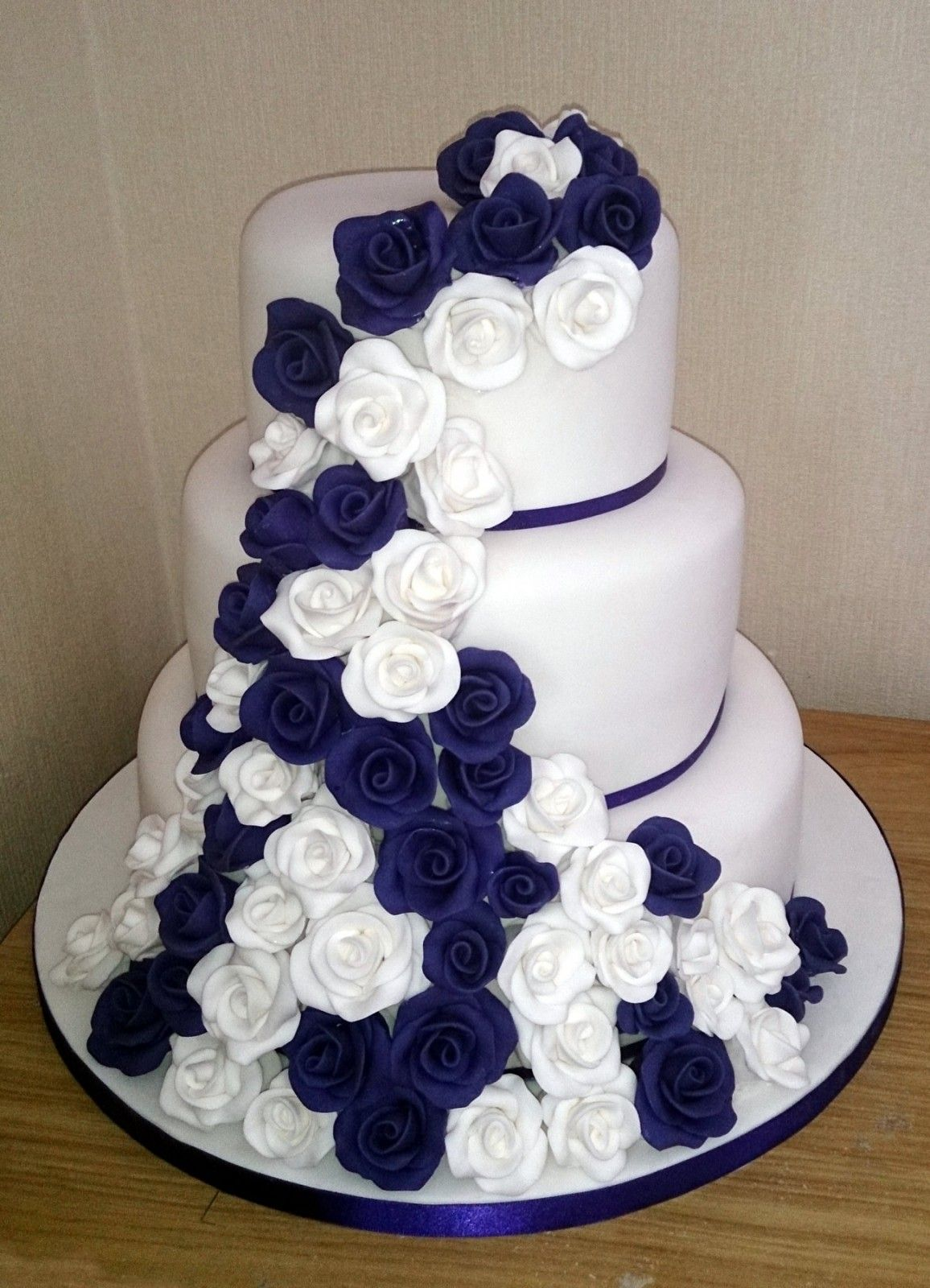 3 Tier White And Purple Rose Wedding Cake Royal Blue Wedding Cakes Wedding Cake Red Wedding Cake Roses