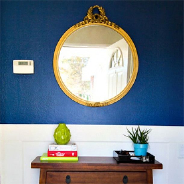 Navy Blue And Gold Foyer. A Dark Blue Accent Wall Makes A