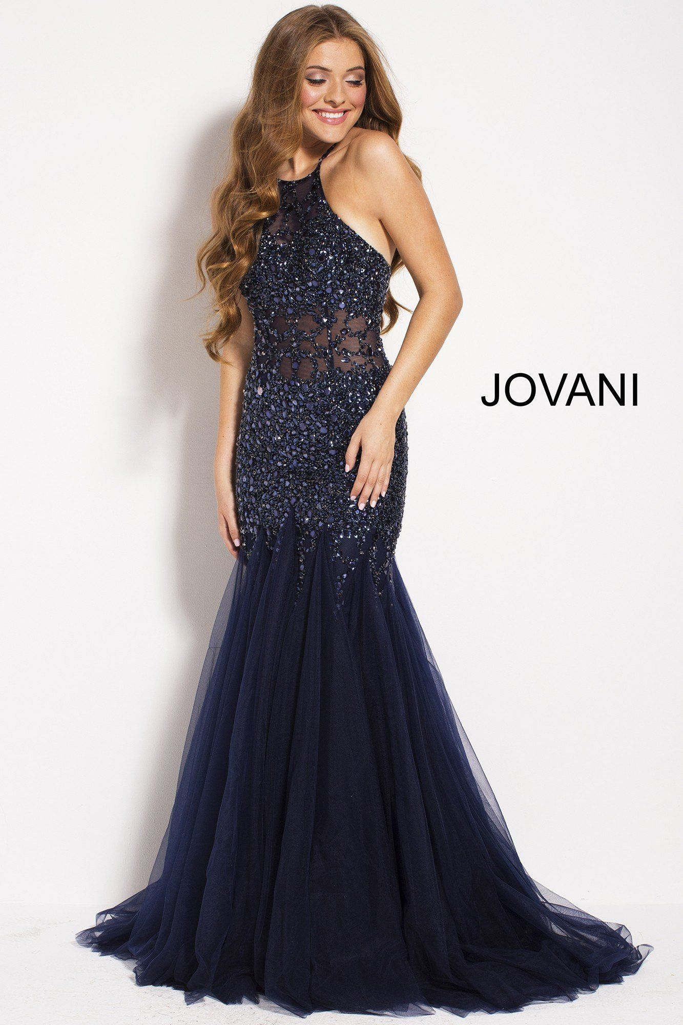 aaeb4da77c3d Redefine glam rock in Jovani 59173. This stunning mermaid gown features a  sheer bodice,