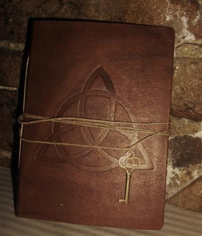 Handmade leather journal engraved with the simbols triquetra or pentagram , if you want can personalize it with word, or your name, initials