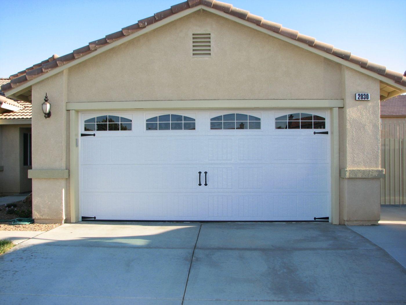 Doors Garage Door Decorative Hardware With A Large Garage White Color Combined Wall Color Gray Buildi Garage Door Installation Custom Garage Doors Garage Doors