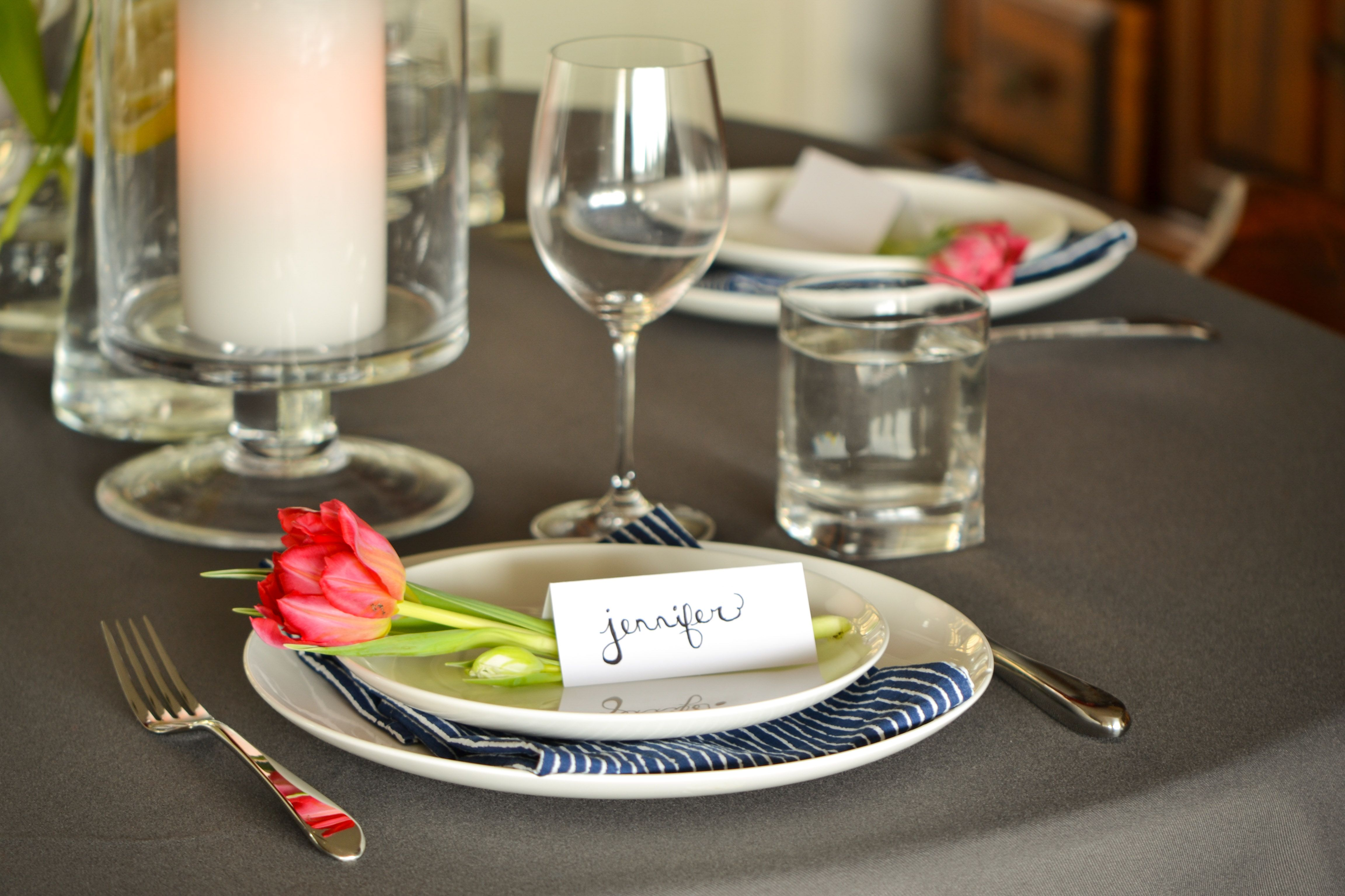Easy tables cape idea - a single bloom at each place setting