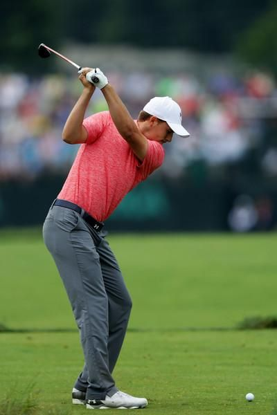d5c38985059 Jordan Spieth wearing Under Armour Official Tour Cap 2.0 in White/Navy, Under  Armour Match Play Golf Pants in Graphite, Under Armour Playoff Polo in  Rocket ...