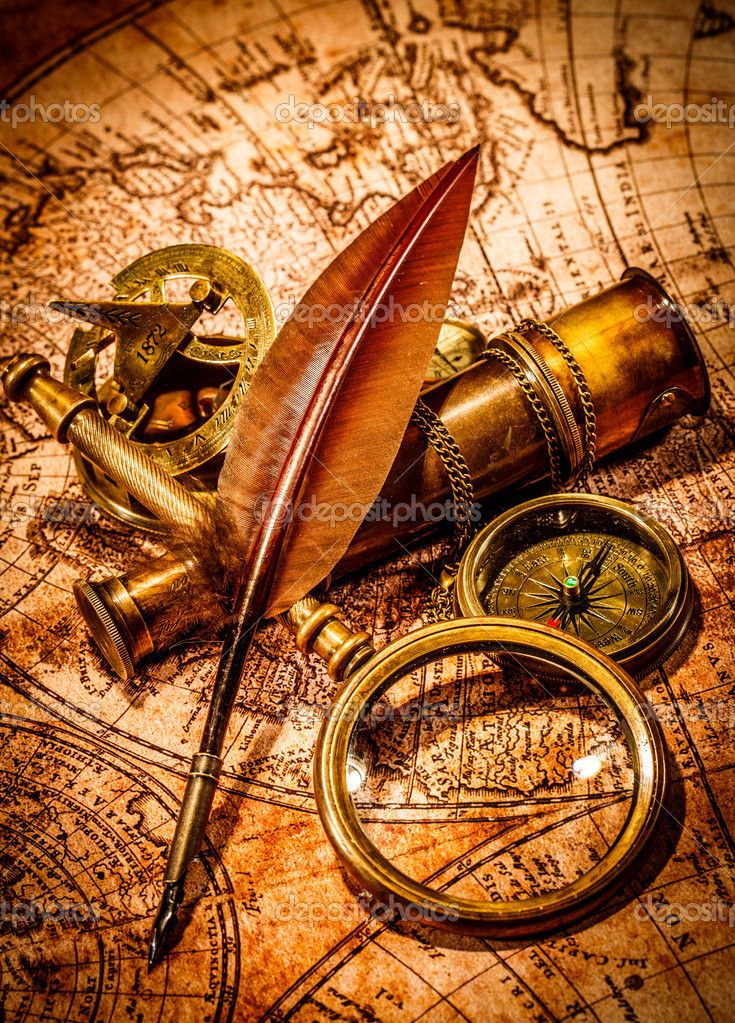 Depositphotos44972355 vintage magnifying glass lies on an ancient photo about vintage magnifying glass compass goose quill pen and spyglass lying on an old map gumiabroncs Images