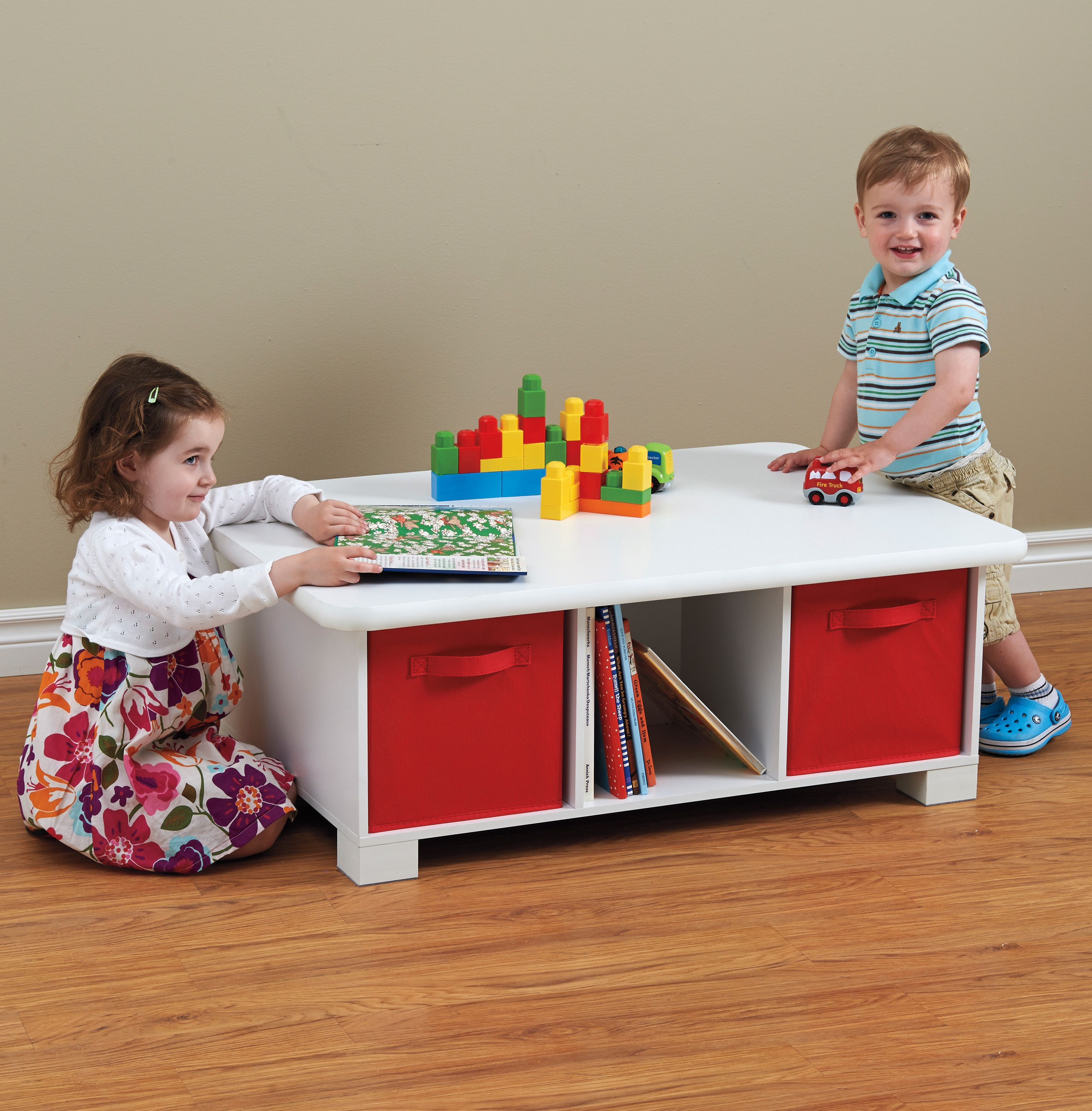 This sturdy, low-sitting play table is both comfortable ...