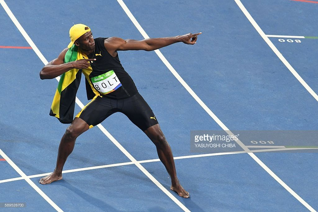 Jamaica's Usain Bolt celebrates after he won the Men's