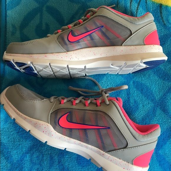 NWOT Nike Sneakers Brand new, only worn around the house once! Size 8.5 women's, super cute color combination with grey, bright pink & blue! Nike Shoes Sneakers