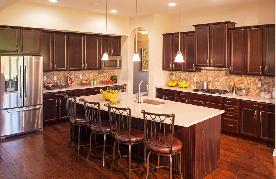 Dallas Kitchen Remodeling Model cherry and quartz kitchen, drees homes, sasha model/floor plan
