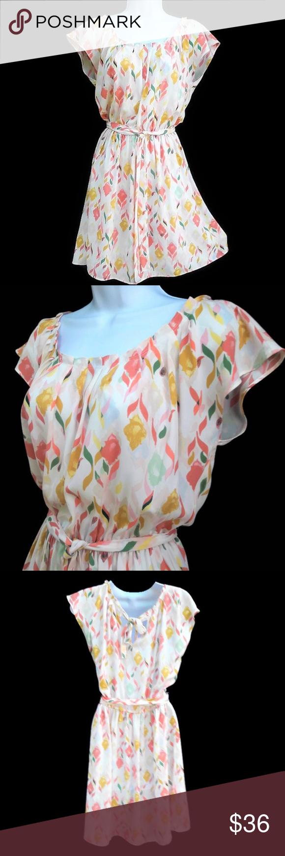 LC Lauren Conrad Dress Spring Pintuck Neckline S LC Lauren Conrad Dress Spring Pin-tuck Neckline. Back Keyhole Tie. Pastels Cream Orange, Yellow, Green. Machine Wash. Tagged size S.  Bust: 22