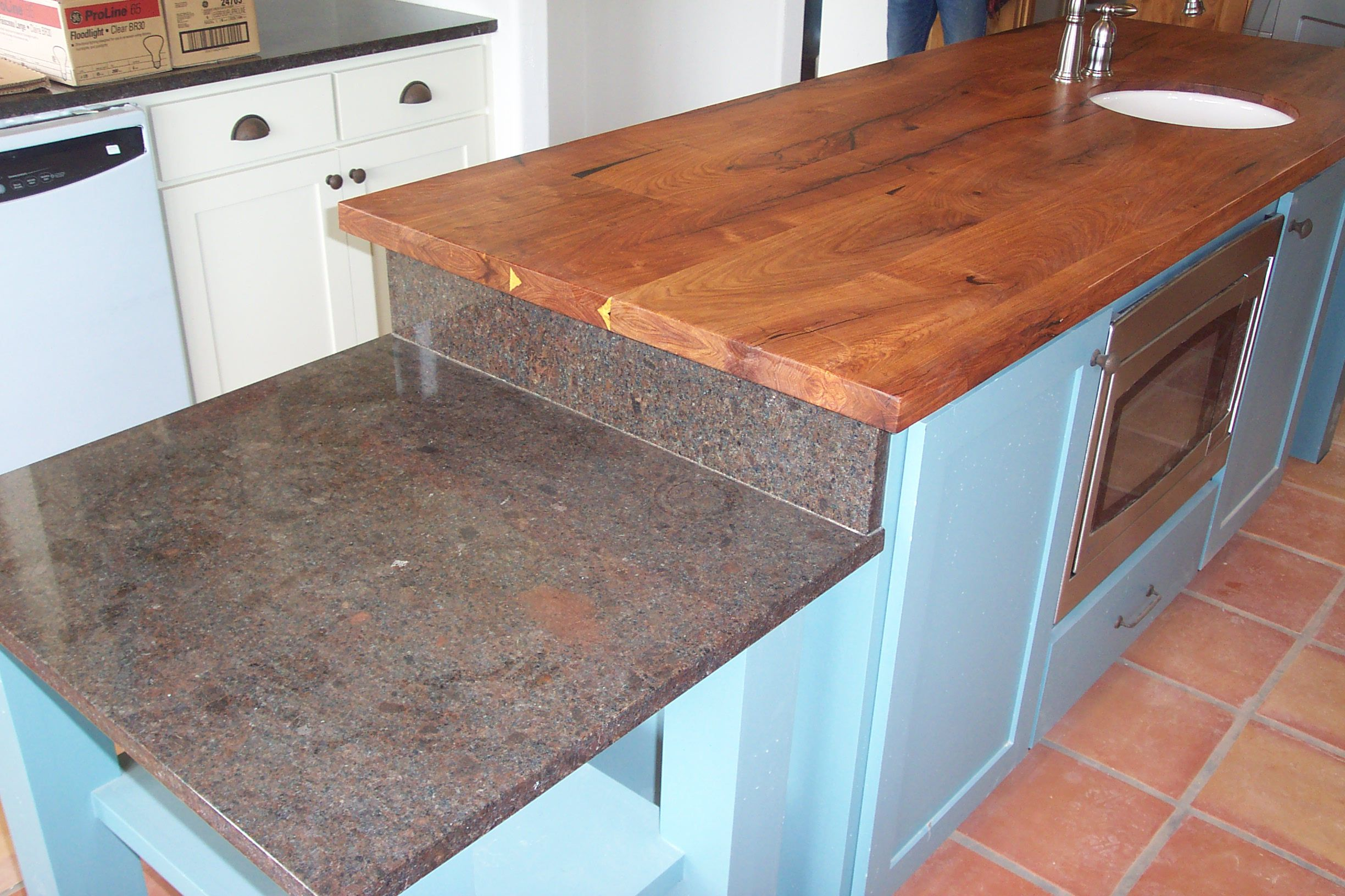 Mixing Granite And Mesquite Works Well In This Kitchen Countertops Kitchen Home Decor