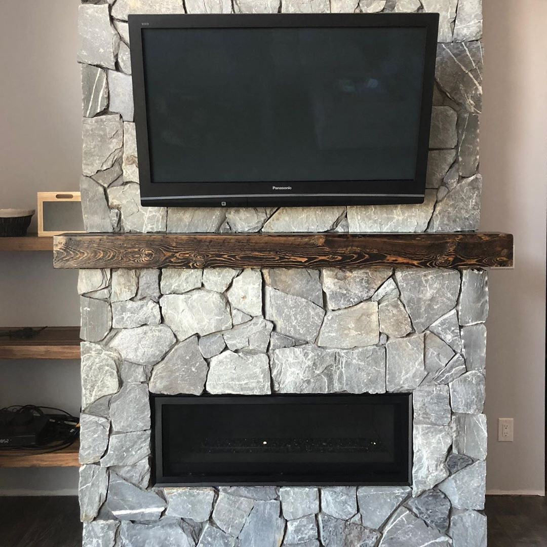 A reclaimed Manitoba fir mantle and Canadian fieldstone for - #homedecor