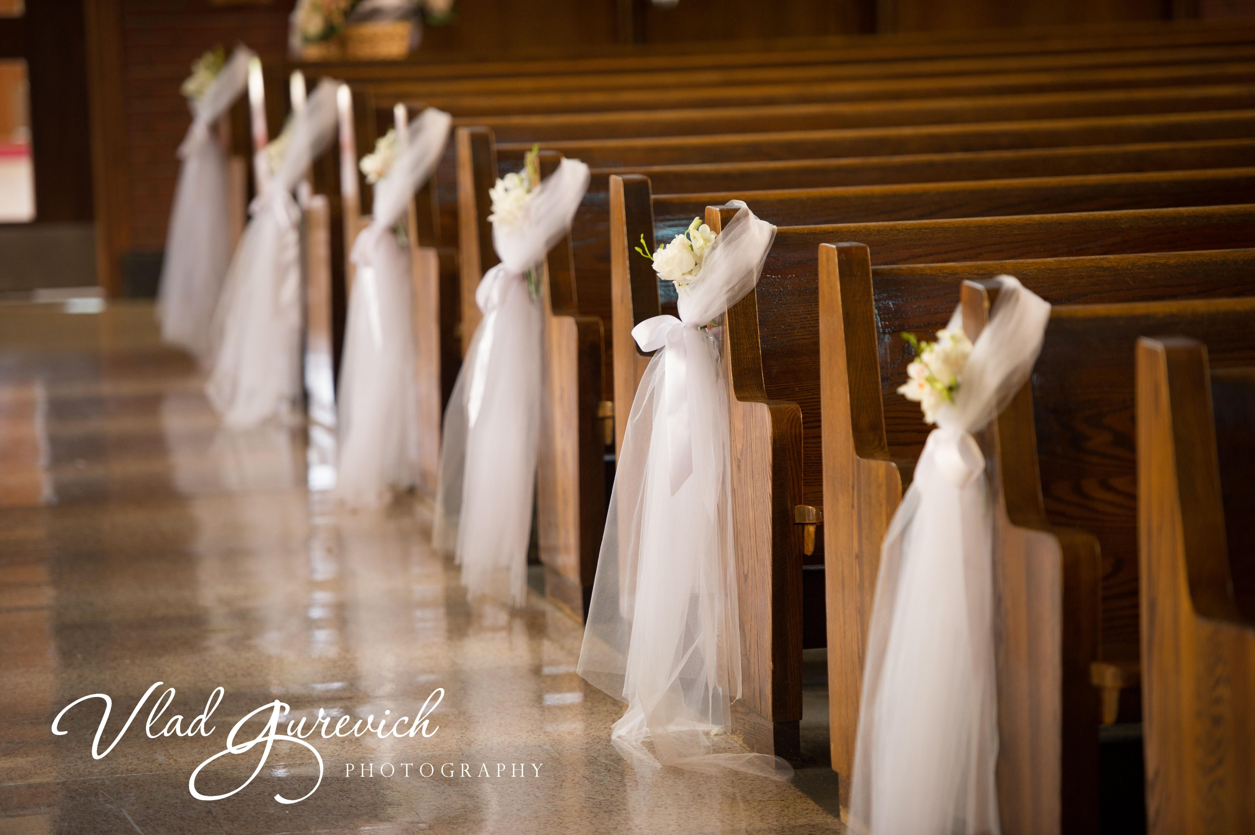 Simple Pew Decor With Swags Of Tulle Accented With Simple