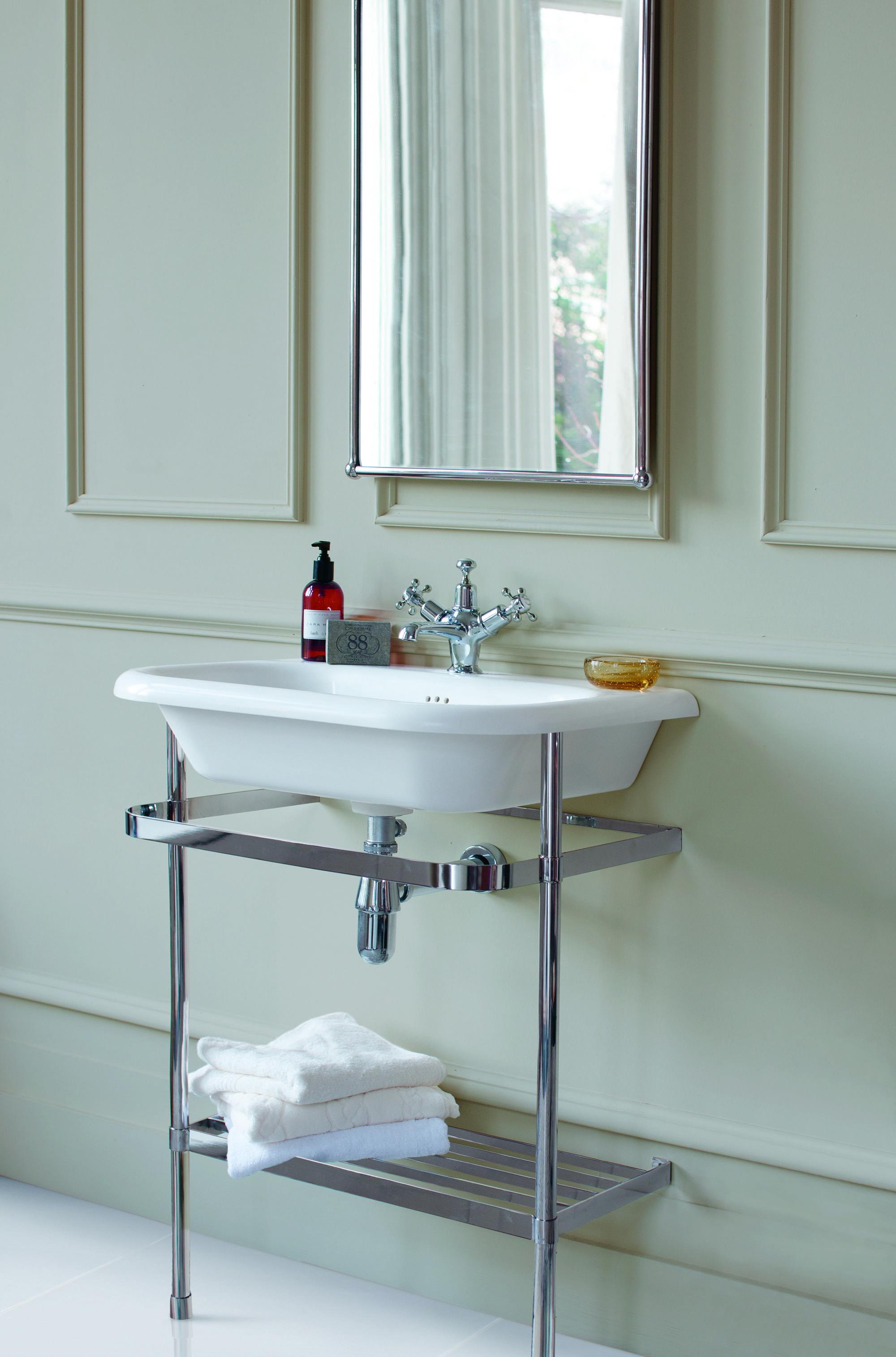 White Sink With Chrome Towel Rail