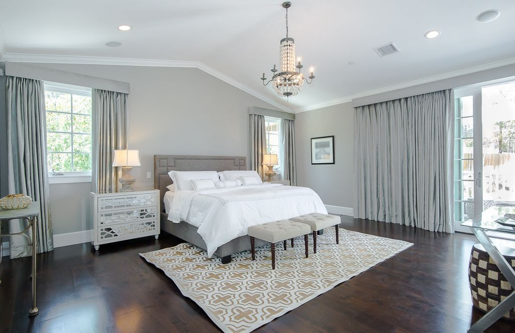 Dark Hardwood Flooring Injects Warmth To This Airy And Spacious Master Bedroom Luxe Bedroom Luxury Bedroom Master Bedroom Wood Floor
