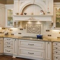 Kitchen. Marvelous Range Hood Designs For Beauteous Kitchens Ideas. Glamorous Hood Designs Kitchens Decoration With White Wooden Carving Vent Hood Combined Mosaic Ceramic Tiles And Granite Counter Tops Featuring White Oak Base Cabinet Ideas. The kitchen is very luxurious look of shapes and colors as well as the selection of furniture. Many additions such as furniture inside the range hood. Has a white color with additional carving in it to make people more excited and eager to have it.