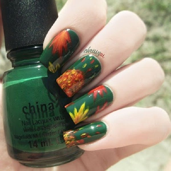 Dark green themed leaf nail art design. Never be too afraid to go with  unique - 35 Leaf Nail Art Ideas