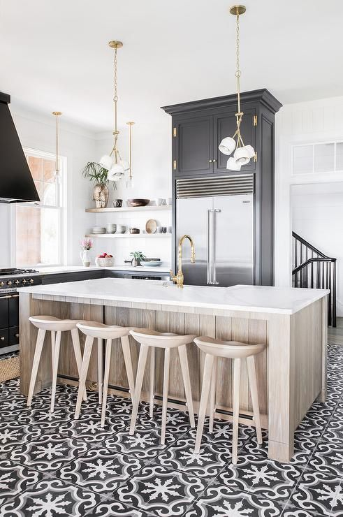 Welcoming Black And White Kitchen Is Accented With An Oak Center Island  Seating Light Wood Tractor Barstools At A White Quartz Countertop Fitted Wiu2026
