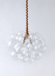 The 31 Glass Bubble Chandelier is a perfect statement lighting fixture for your dining room living room or anywhere you want to make a statement. #statementlighting #lightfixtures #modernlighting  The 31 Glass Bubble Chandelier is a perfect statement lighting fixture for your dining room living room or anywhere you want to make a statement. #statementlighting #lightfixtures #modernlighting