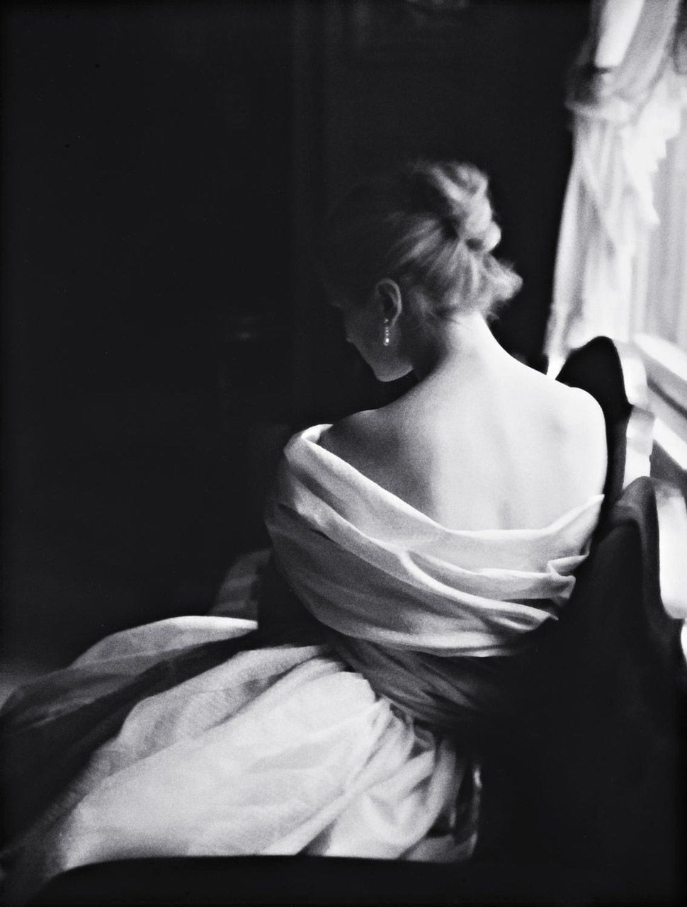 the way the light delicately shines on her bare shoulders, lingering ever so gently.