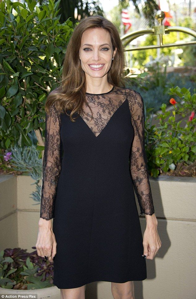 263a1bb4a5c6 Stunning  The 38-year-old actress kept things simple but classy as she wore  an A-line black mini dress with lace detailing