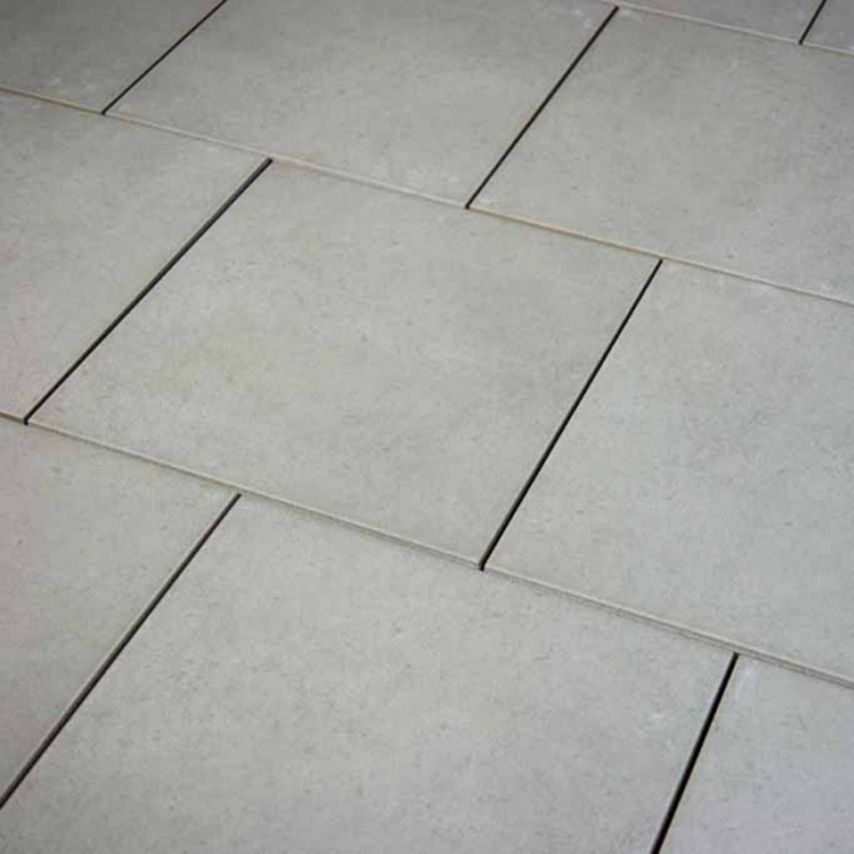 A medium sized light grey floor tile, specifically designed to stop ...