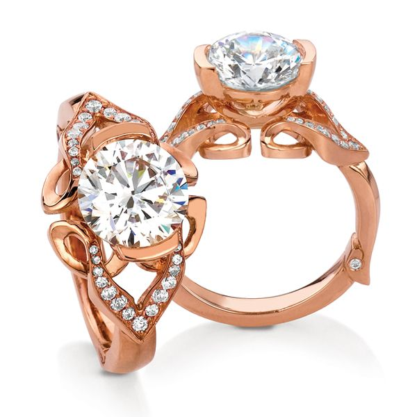 Paisley engagement ring by MaeVona: Sculpted shank with pave diamond details sets a round brilliant-cut diamond center in a modern demi-bezel setting. Named after the Scottish town Paisley