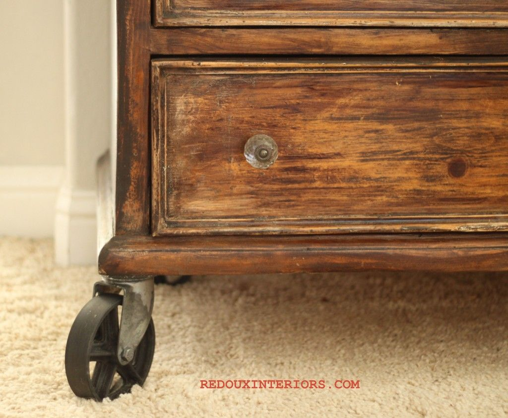 Add casters to the bottom of the dresser.  What a great idea for a vintage look1