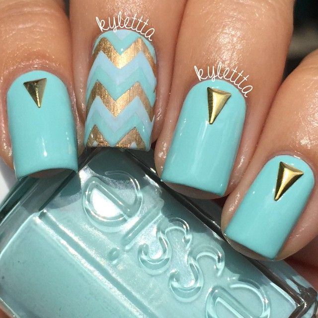 I just love chevrons  this chevron design was made with the Kylie vinyls from @twinkled_t #twinkledt. Essie- 'Blossom Dandy', Maybelline-'Bold Gold' and Formula X- 'Infatuated'. The gold triangles are from @bornprettystore