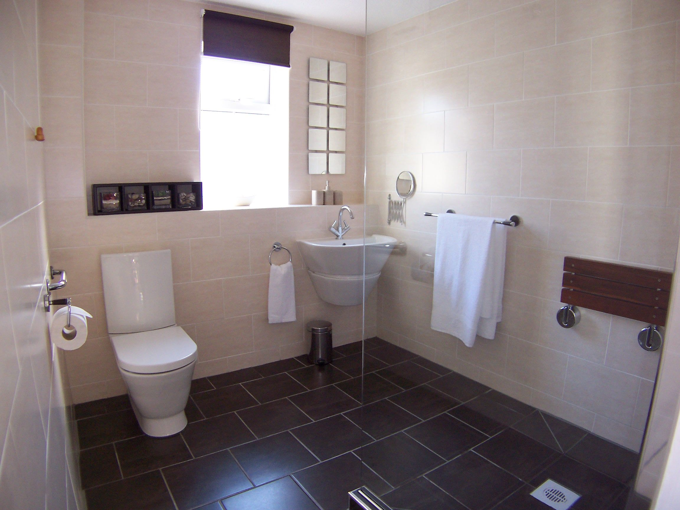 Fully Tiled Bathroom Fully Tiled Wet Room With Wheel In Shower Fold Away Wall Hung