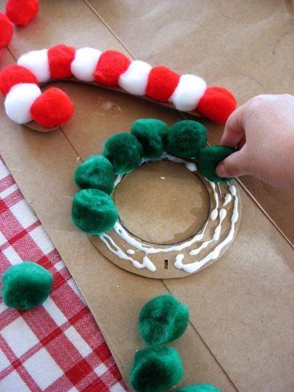 Glue pom poms to cardboard to make fun ornaments with kids