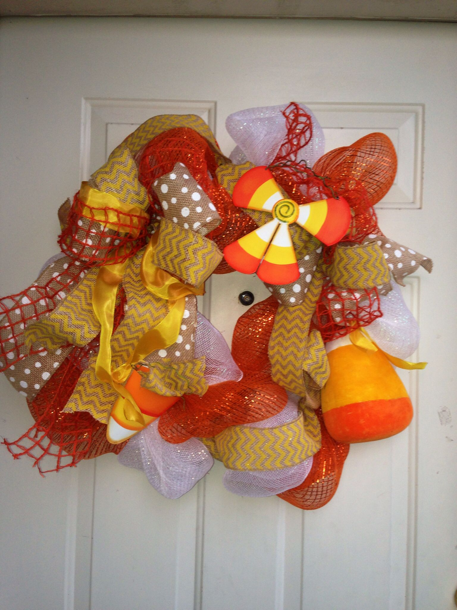 A candy corn and chevron theme party isn't complete wo a wreath!