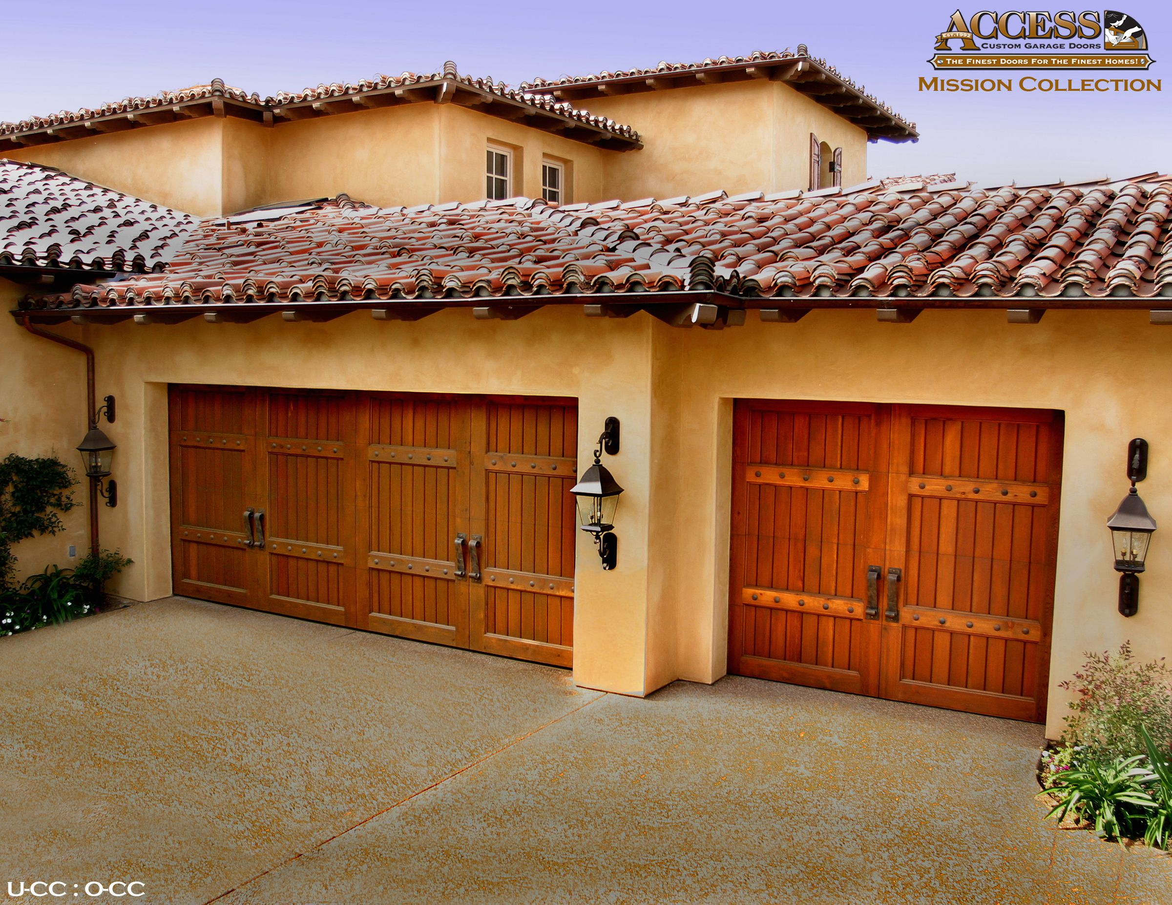 Check Out These Beautiful Spanish Revival Style Garage Doors Designed And Installed By Access Custom Door An In 2020 Custom Wood Garage Doors Custom Door Garage Doors