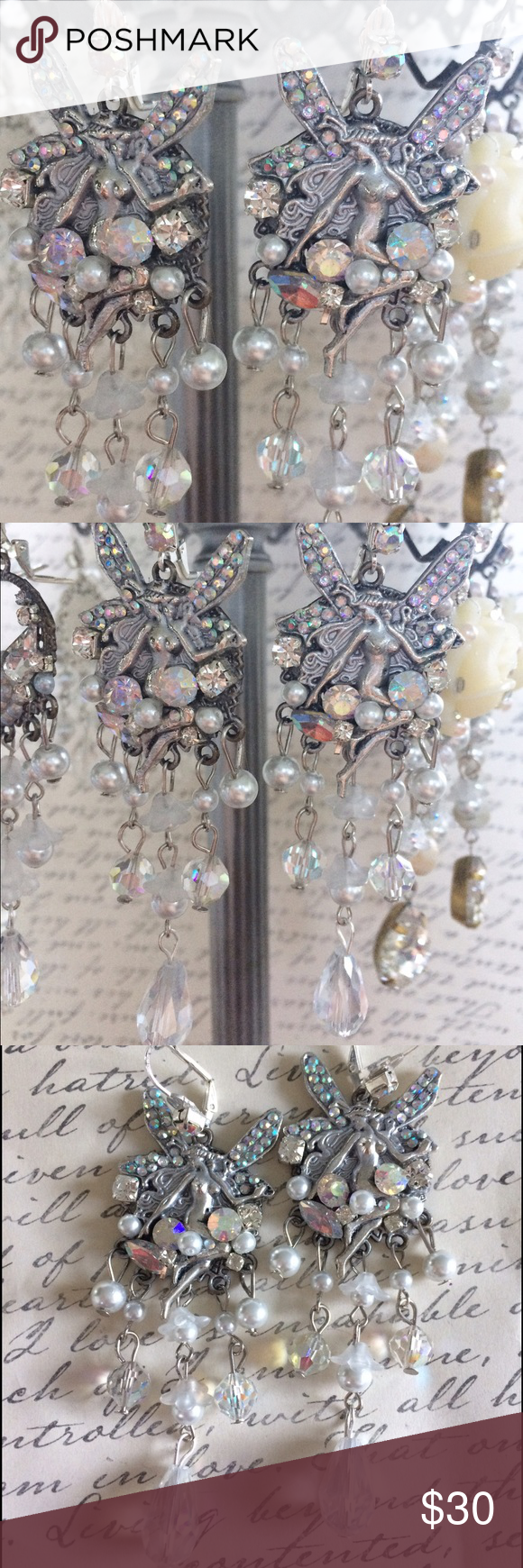 Fairy bridal earrings These are silver bridal fantasy earrings great for a bride who has a whimsical side. These are an over the top hand made one of a kind art by Caitlin Ranck Caitlin Ranck  Jewelry Earrings