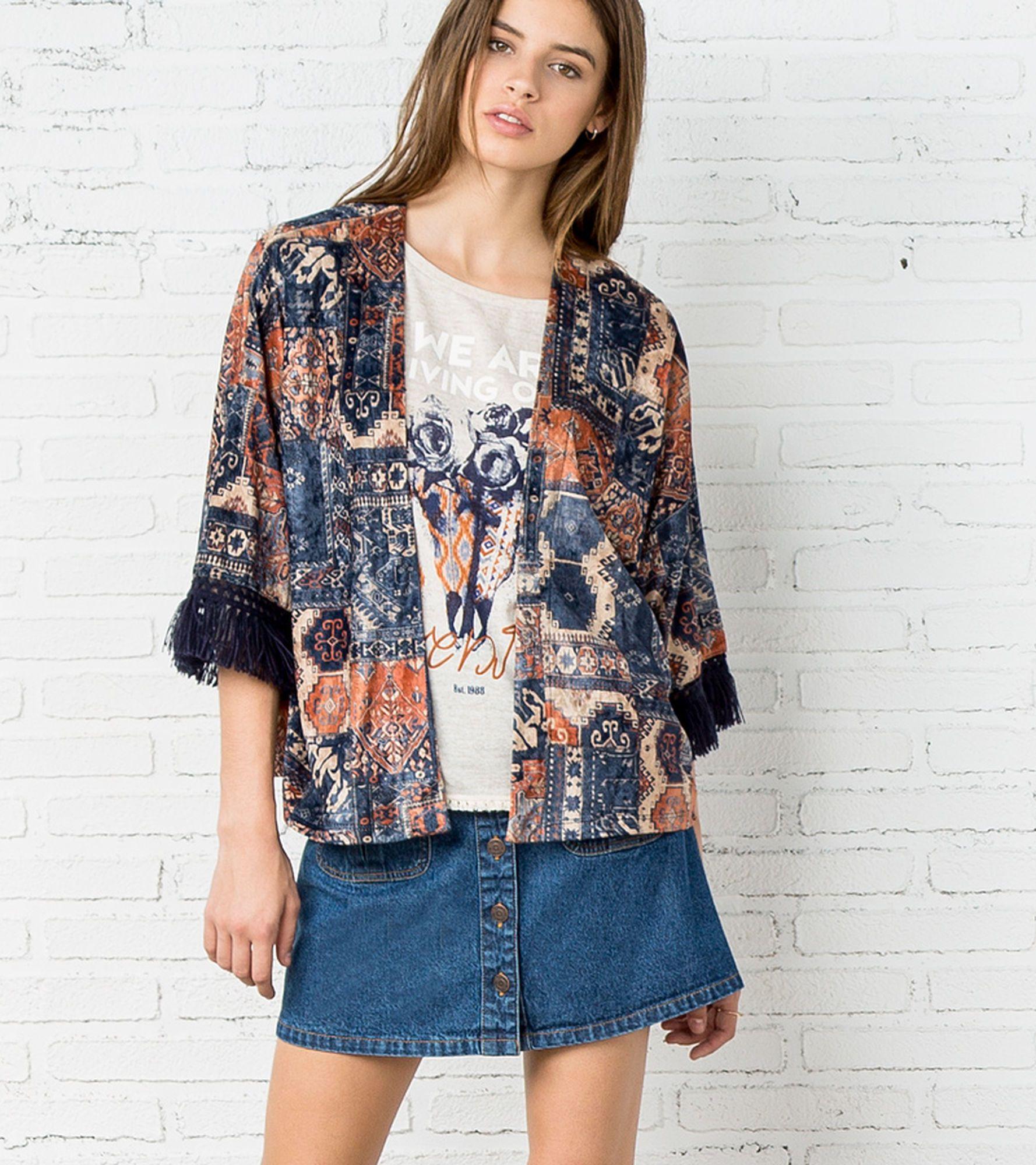 Fringed, velvet kimono with three-quarter length sleeves and geometric motif.