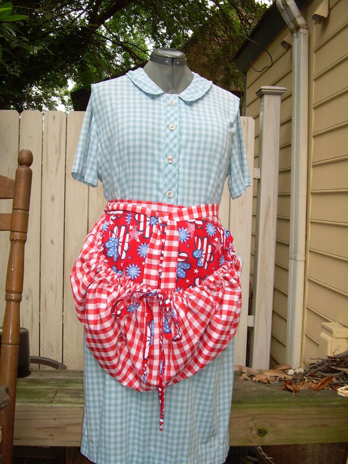 Reversible Red, White and Blue Flowers and Red Gingham Gathering Apron. $30.00, via Etsy.