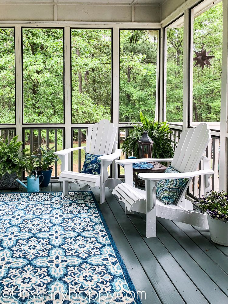 Screened in porch decor with white adirondack chairs and ...