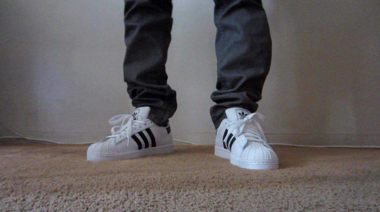 adidas superstar black and white on feet