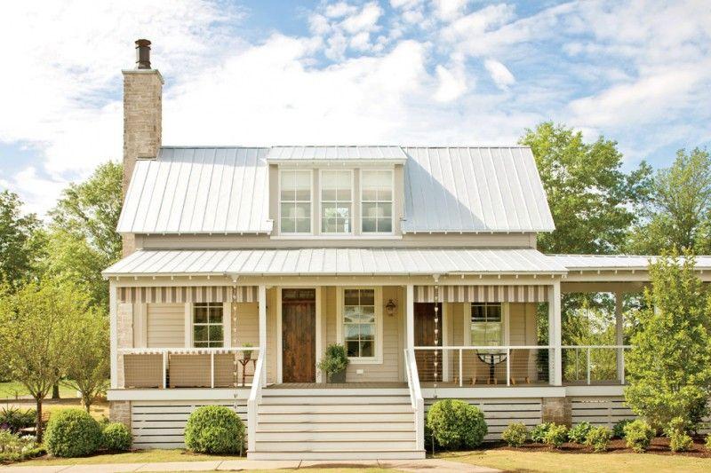 farmhouse exterior idea with white wood skirting stainless