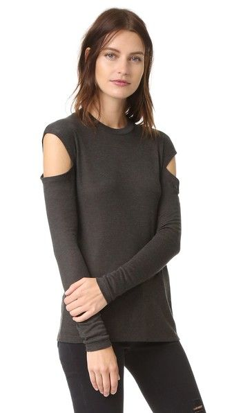 Cutout shoulders reveal a peek of skin on this soft jersey IRO.JEANS top. Banded crew neckline. Long sleeves.
