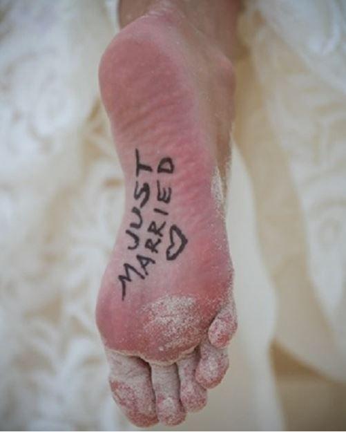 Love this photo! So cute and what a great idea for a beach wedding!