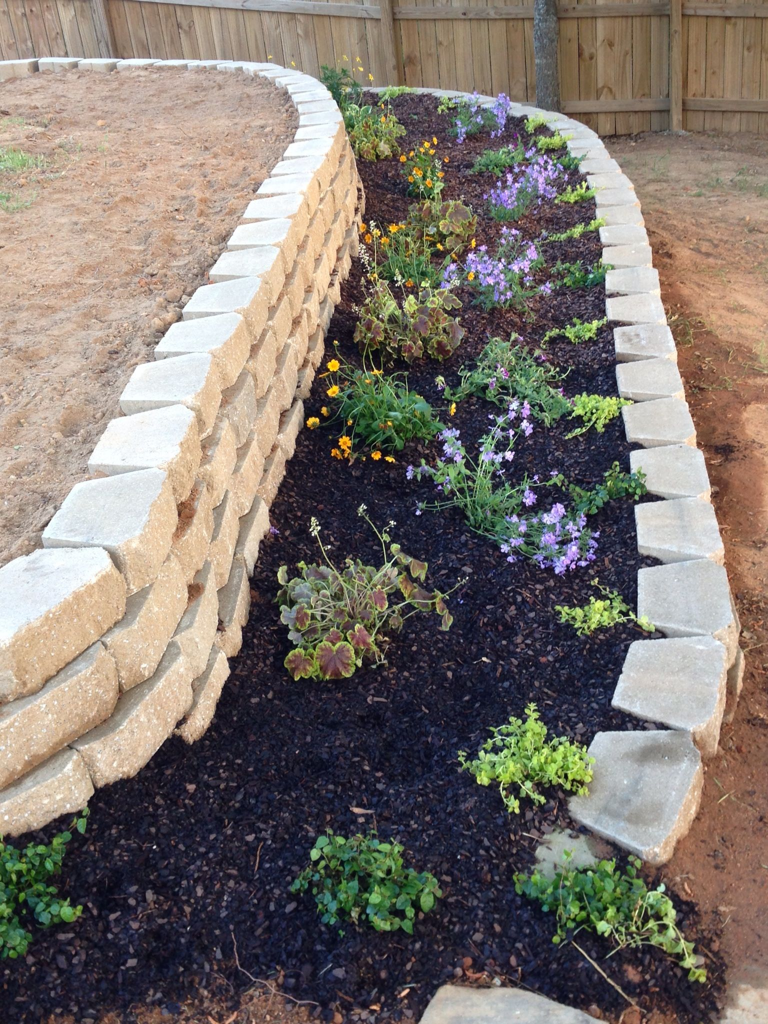 Landscaping Ideas For Uneven Yard : Retainer wall flower bed for an uneven backyard back yard in progress