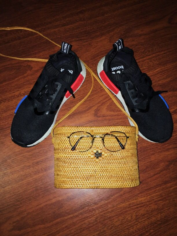 My essentials/ purse was hand made in Thailand / Big round glasses/ NMD  adidas
