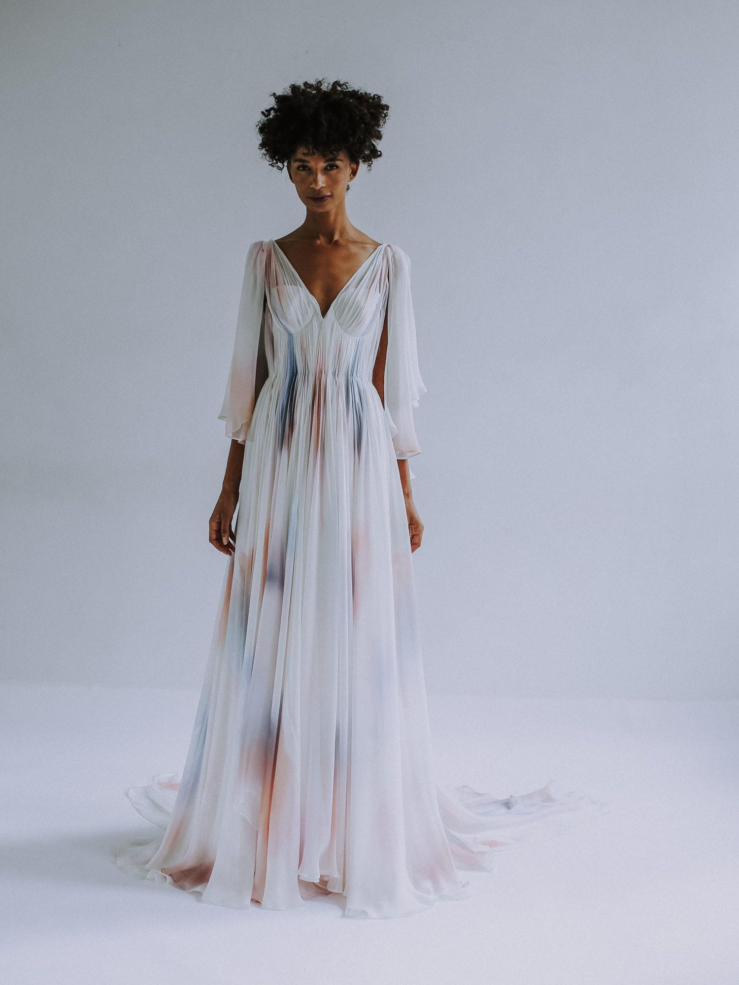 545b8df24c4 pastel and ivory printed feather weight silk chiffon grecian draped gown  over structured foundation bustier bodice. Removable scarf sleeve detail.