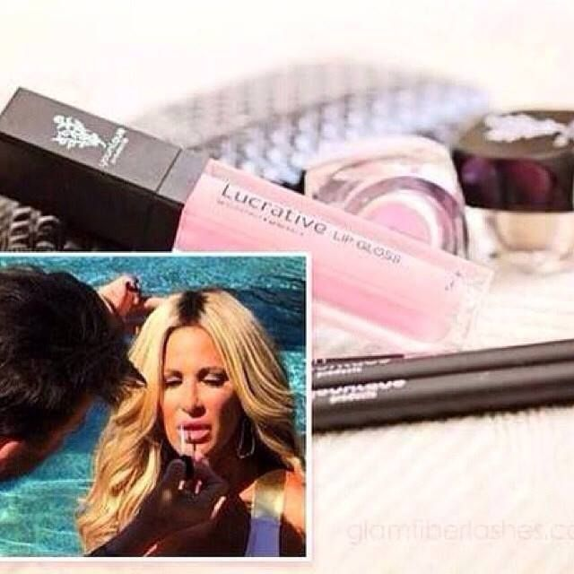 LOOK who loves our lip gloss!!! Kim Zolciak Biermann loves our mascara, and now loves our lip gloss too!! She is wearing loveable here. Our lip gloss is not sticky and has a cute little mirror on the side.  #BeautyIsBewitching #Younique #LucrativeLipGloss  Shop: https://www.youniqueproducts.com/nicolecunha/party/991010/view