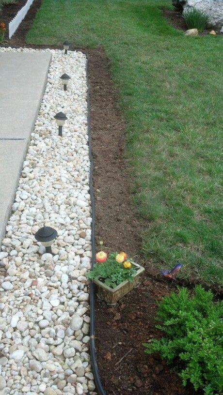 Create An Additional Flower Bed In Front Of Rock Path I Used A Large Bread Knife To Easily Remove Gr Now You Won T Have Worry About Rocks W The Lawn