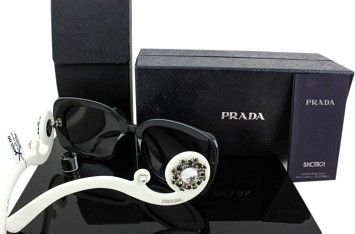 GB1022368 Prada Sunglasses Limited Edition Prada Baroque SPR 33P Size   54-19-135 Black front and Off-White sides with black and… 74ad5d8f16c1f