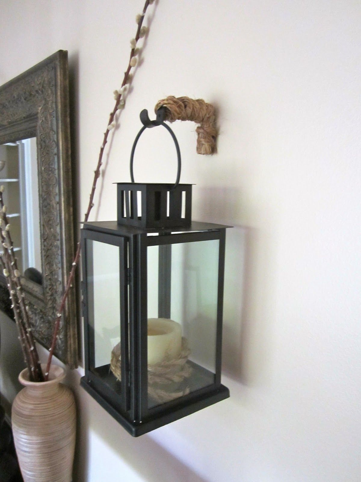 Repurposing Old Curtain Rod Bracket To Hold Lanterns On Wall