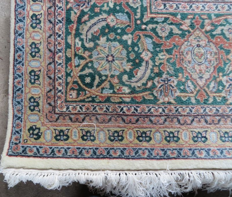 "100% wool Karastan style rug with emerald green border and wine, off white and blue gray tones in center, excellent condition, no spots or stains, 13.5'x8'8""."