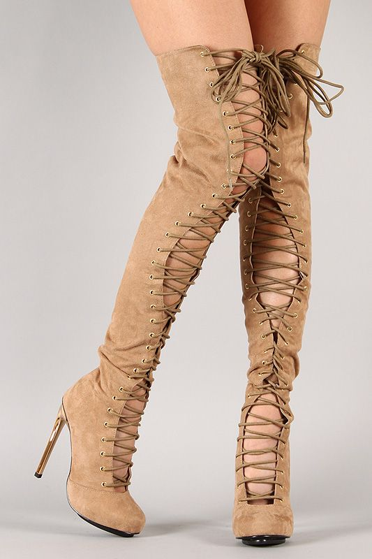 Grab anyone attention with this impressive thigh high boot! Featuring round toe, smooth faux suede throughout, corset-inspired lace up construction at front shaft, low platform, and metallic accent stiletto heel. Finished with cushioned insole, smooth lining, and rear zipper closure for easy on/off.