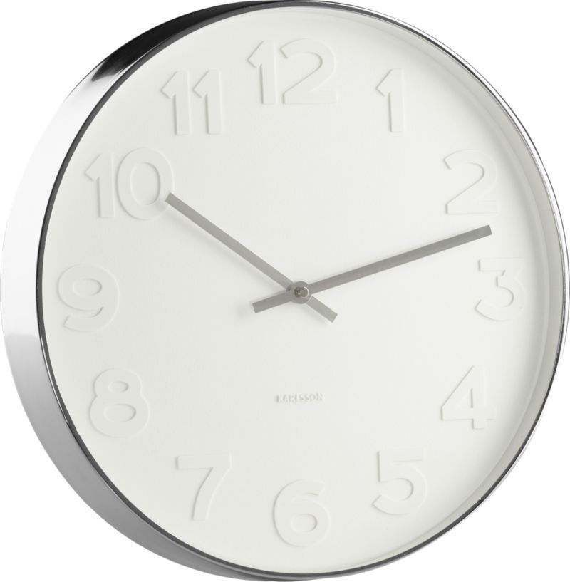 Our Monochromatic Wall Clock Is Embossed With Large White Numerals On A White Face And Accented With A Stainles Wall Clock Contemporary Wall Clock Modern Clock